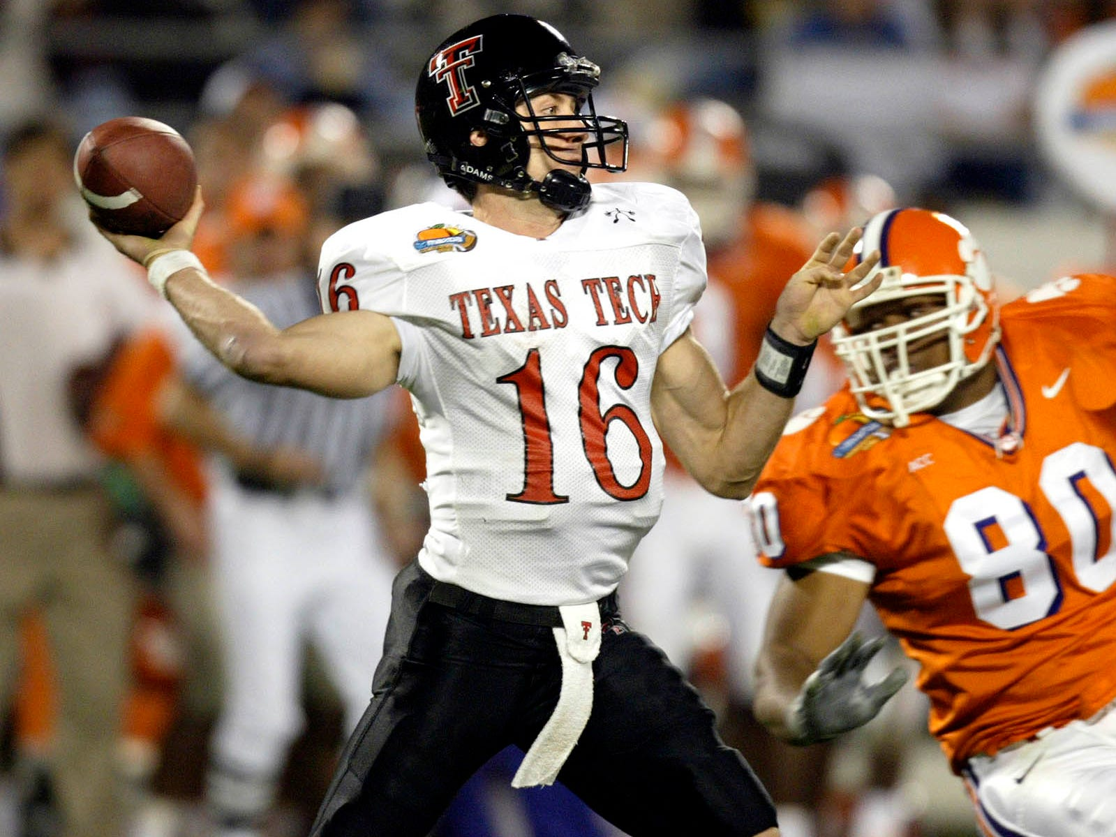 Texas Tech quarterback Kliff Kingsbury throws downfield against Clemson at the Mazda Tangerine Bowl on Monday, Dec. 23, 2002 in Orlando, Fla. Kingsbury threw for 375 and three touchdowns as Texas Tech defeated Clemson 55-15.