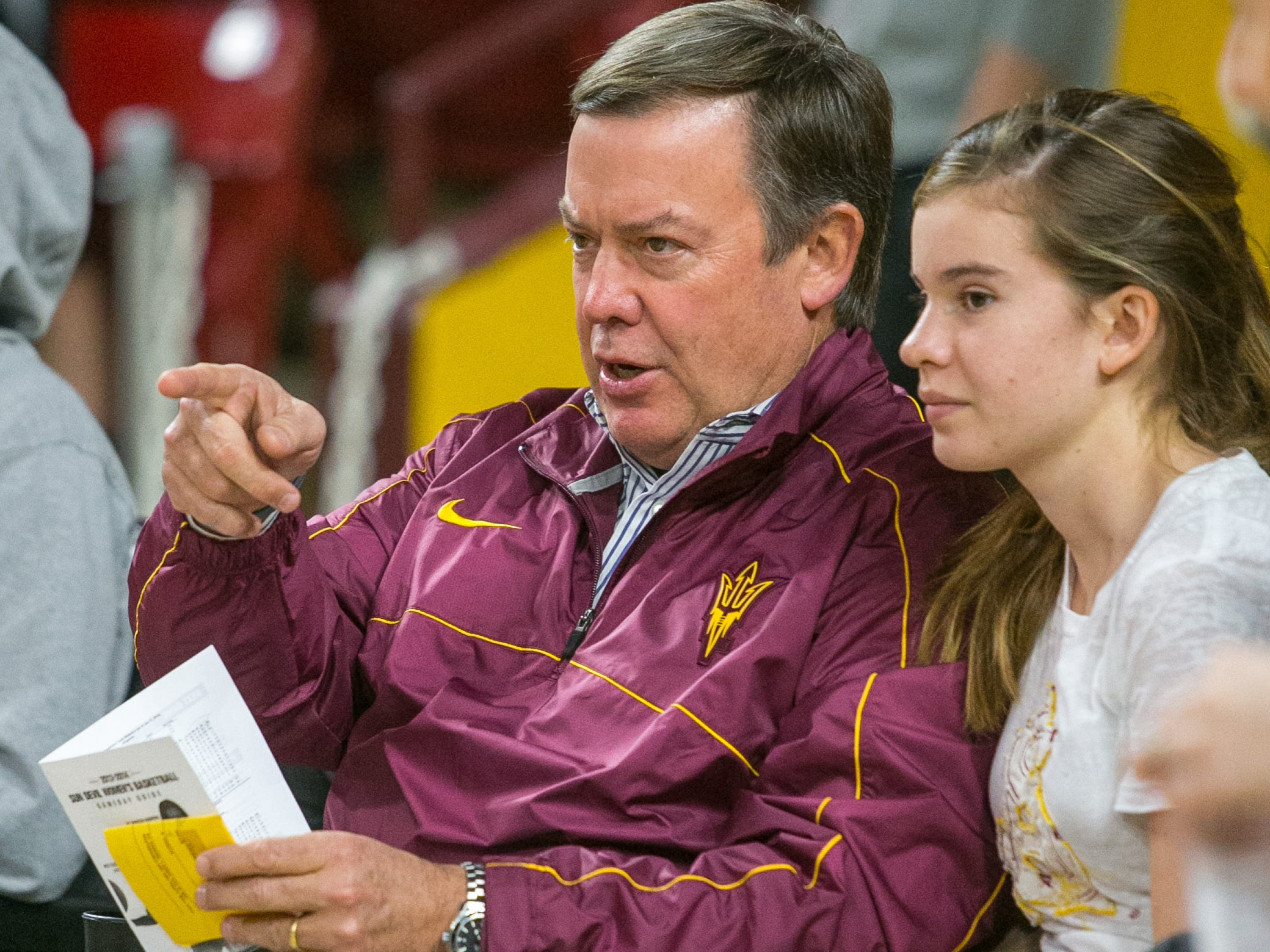 ASU President Michael Crow attends a 2014 NCAA women's basketball game against Stanford at Tempe's Wells Fargo Arena.