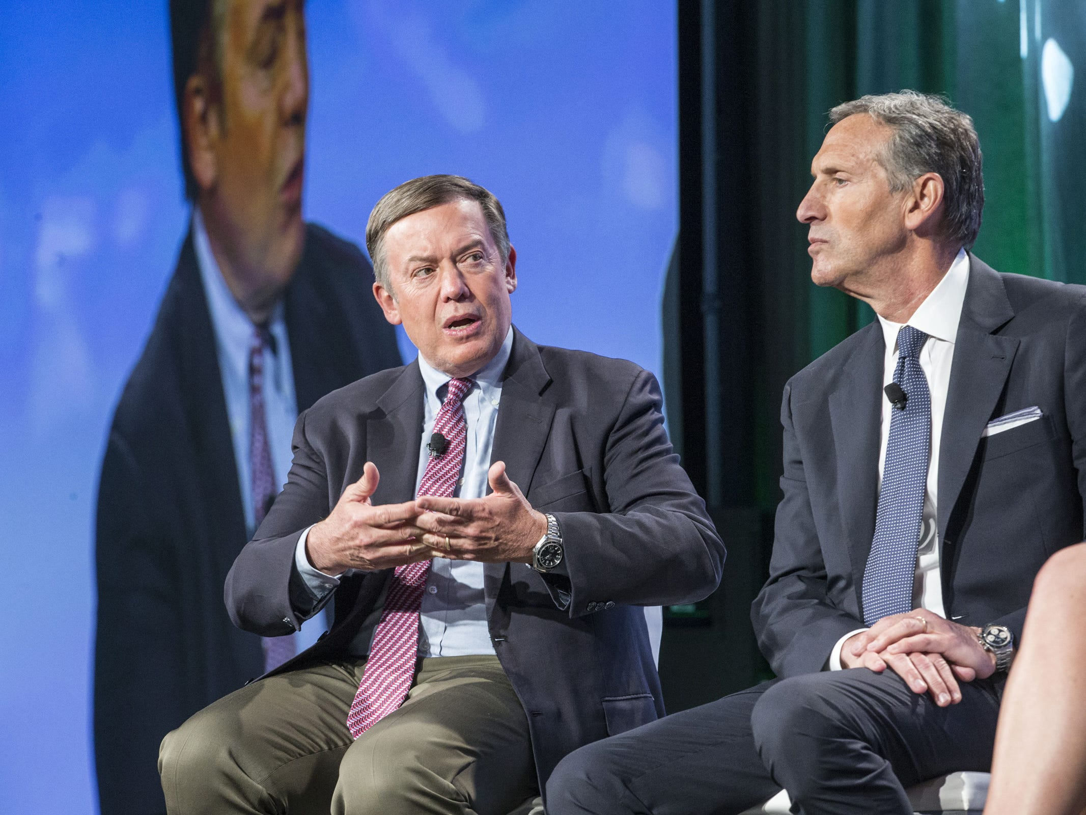 ASU President Michael Crow (left) discusses the expansion of an education partnership with former Starbucks Chairman and CEO Howard Schultz during a 2015 learning innovations conference. The partnership gives Starbucks employees free tuition reimbursement for taking online classes through ASU.