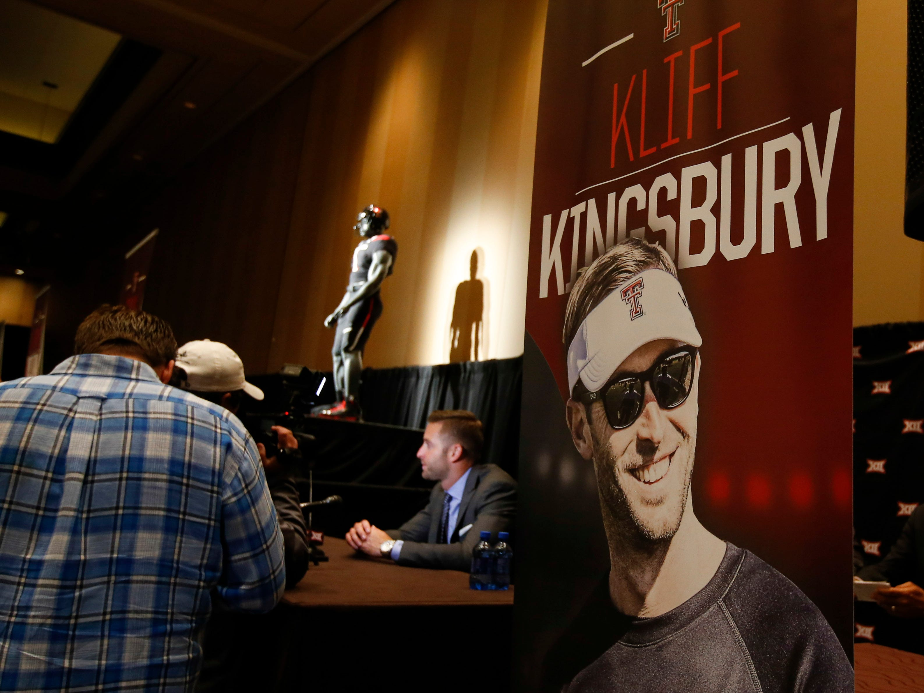 Texas Tech head coach Kliff Kingsbury speaks to the media during the 2014 Big 12 Media Day in Dallas.