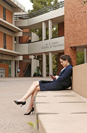 Katie St. Peter, a marketing student, checks her phone outside the W. P. Carey School of Business at the ASU campus Tempe on Oct. 15, 2015.
