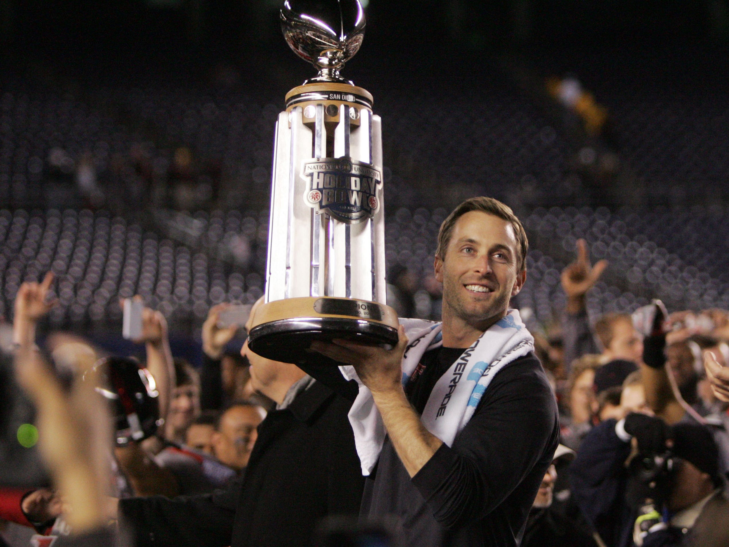 Texas Tech head coach Kliff Kingsbury holds the Holiday Bowl Trophy after defeating Arizona State at Qualcomm Stadium on Dec. 30, 2013 in San Diego.