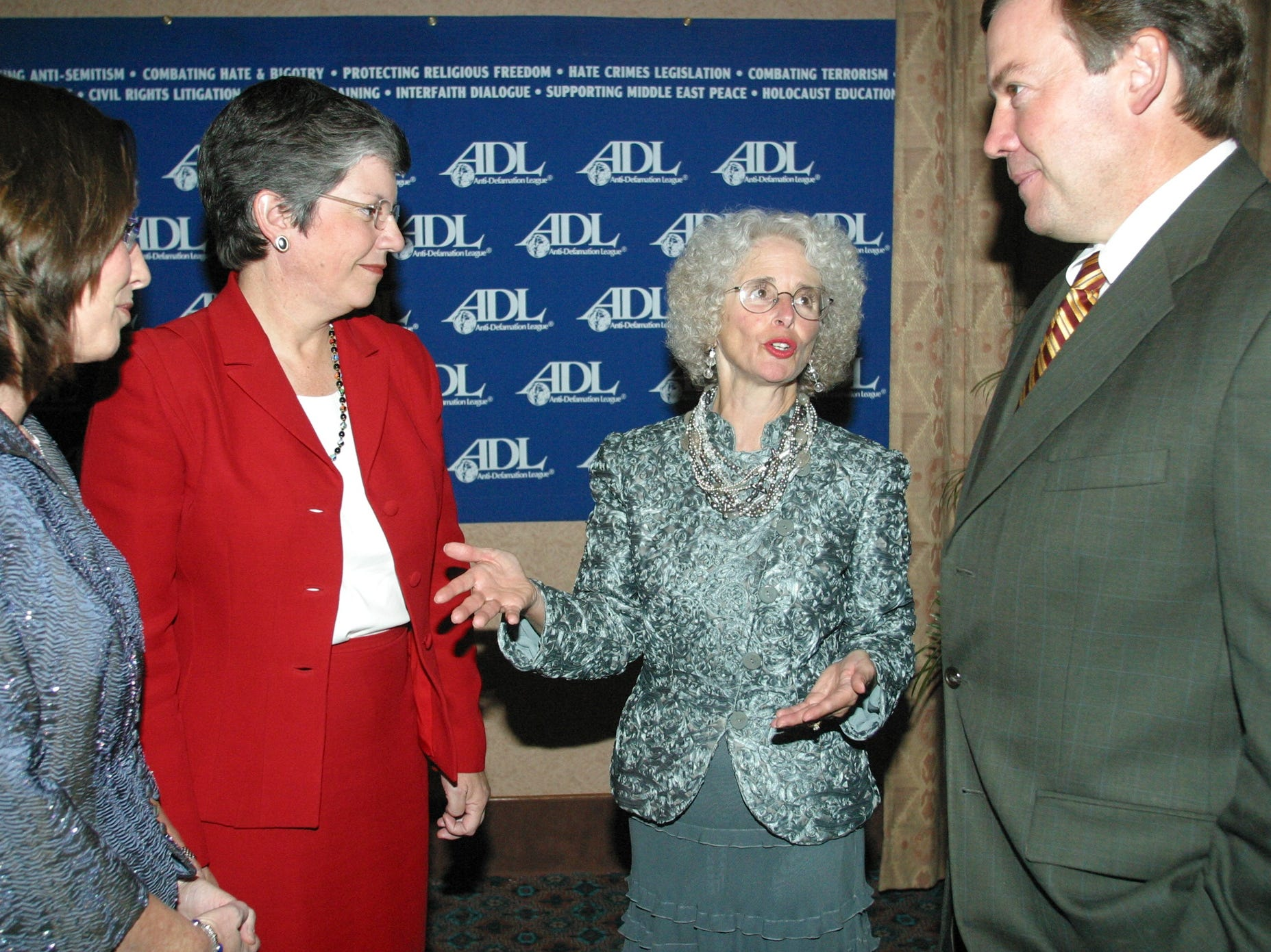 Kris Garrett, former governor Janet Napolitano, Sue Clark-Johnson and Michael Crow visit at the Anti-Defamation League Dinner at Camelback Inn in 2003.