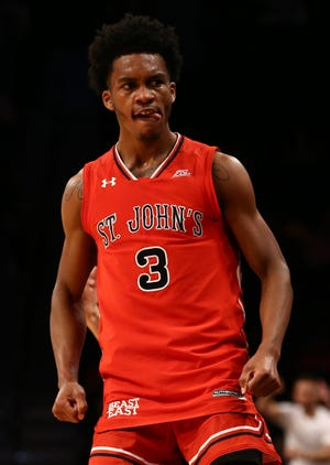 Nov 20, 2018: St. John's Red Storm guard Mikey Dixon (3) reacts during in the second half of the championship game of the Legends Classic against the Virginia Commonwealth Rams at Barclays Center.