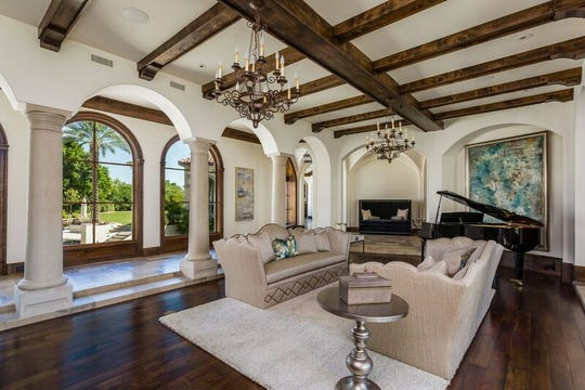 This Paradise Valley estate purchased by Dean Graziosi features vaulted ceilings, marble flooring and an outdoor living room with fireplace and kitchen.