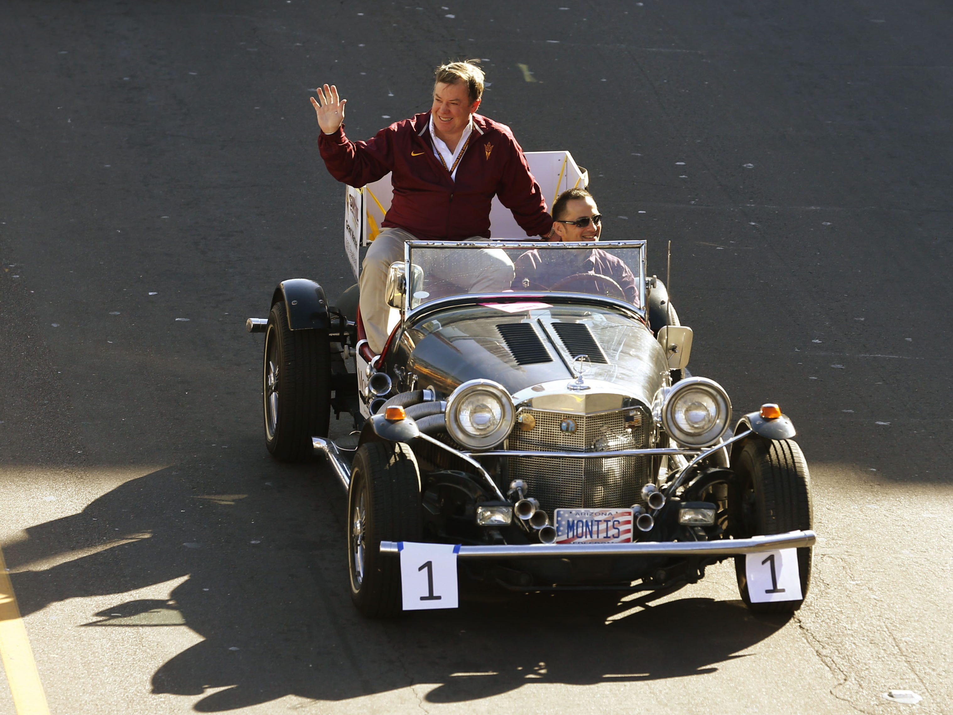 ASU President Michael Crow waves to alumni during the 2012 ASU Homecoming parade in Tempe.