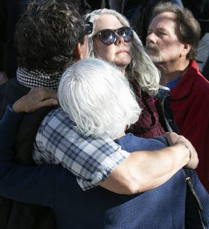 """Friends and family reflect on the eighth anniversary of the Jan. 8, 2011, """"Congress on Your Corner"""" shooting during a commemoration at Tucson Fire Central on Jan. 8, 2019, in Tucson."""