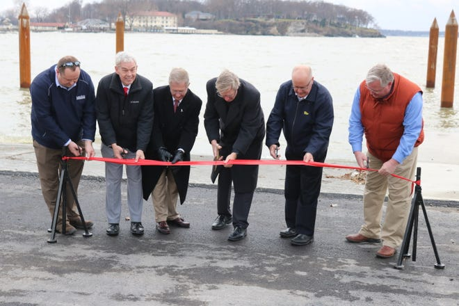 State and local officials cut a ceremonial ribbon for the opening of the new boat ramp at Catawba Island State Park.