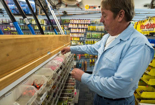 Anderson's Pro Bait manager Bob Jury sorts through different fishing jigs Tuesday, Jan. 8, 2019 inside the Port Huron store.