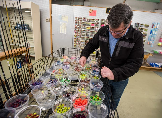 Anglers Outfitters owner Bill Barrons looks through containers containing fishing jigs of different weights and colors Tuesday, Jan. 8, 2019 at Anglers Outfitters in St. Clair.