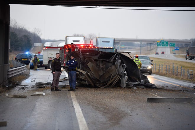 A semi crashed into the Range Road overpass on westbound Interstate 69 about 3:30 p.m. Tuesday, resulting in the freeway being shut down and traffic to be backed up. It was later found that the trailer wasn't properly secured after dropping off corn at an ethanol plant in Marysville.