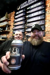Gift Horse Brewing Company co-owner Jason Snyder and brewer Josh Jacobs, left, at the bar at the York City brewery Tuesday, Jan. 8, 2019. Snyder says that due to the government shutdown, the Alcohol and Tobacco Tax and Trade Bureau has ceased operations, delaying approval of labels for four beers he is planning to market. Bill Kalina photo