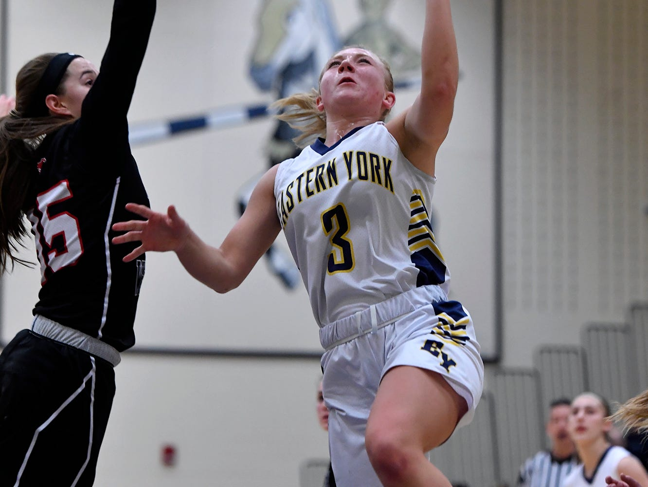 South Western's Taylor Geiman tries to block Cass Arnold of Eastern York as she drives to the hoop, Monday, January 7, 2019. John A. Pavoncello photo
