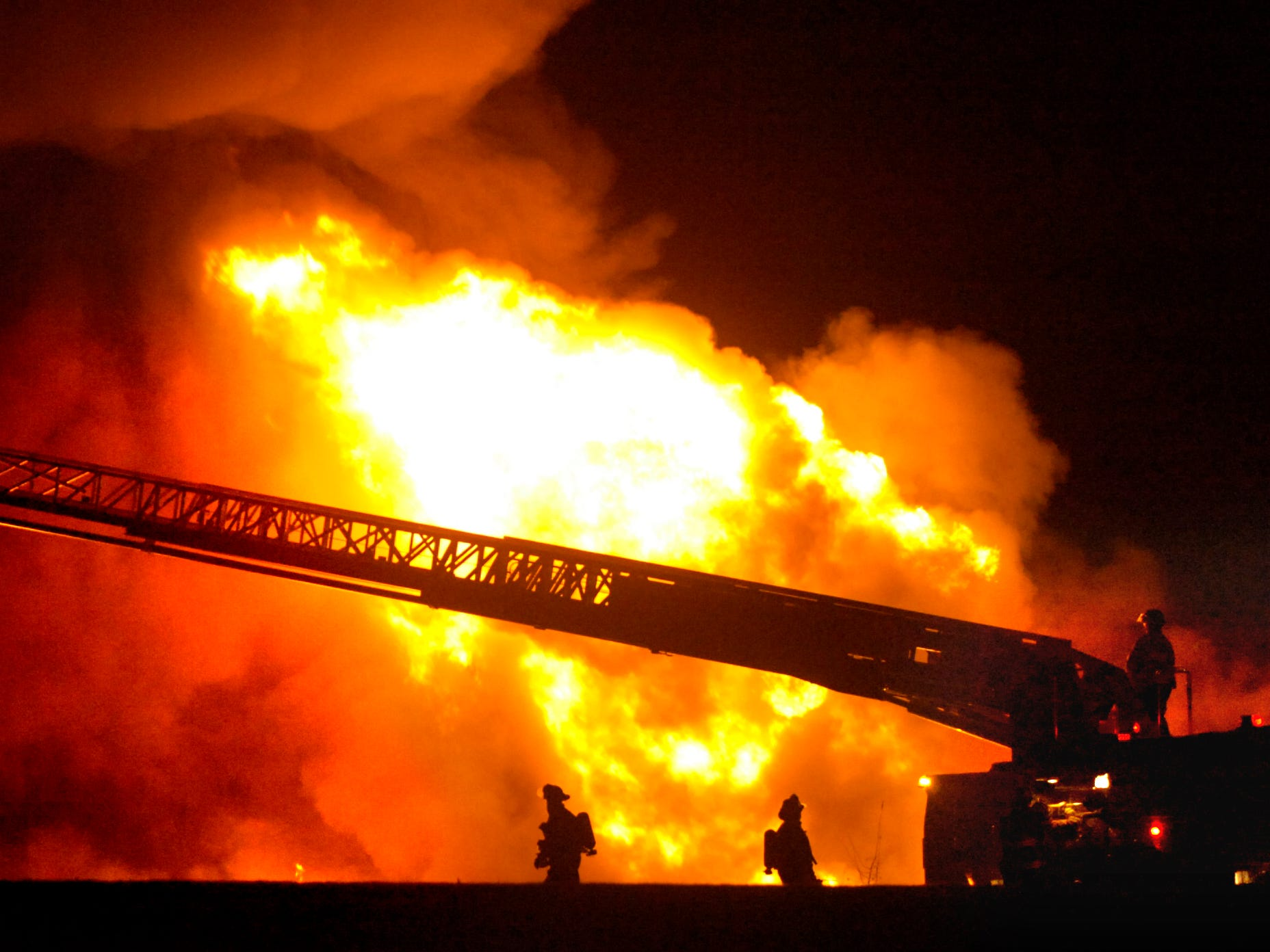 A ladder truck works on the Adhesives Research fire January 10, 2006.