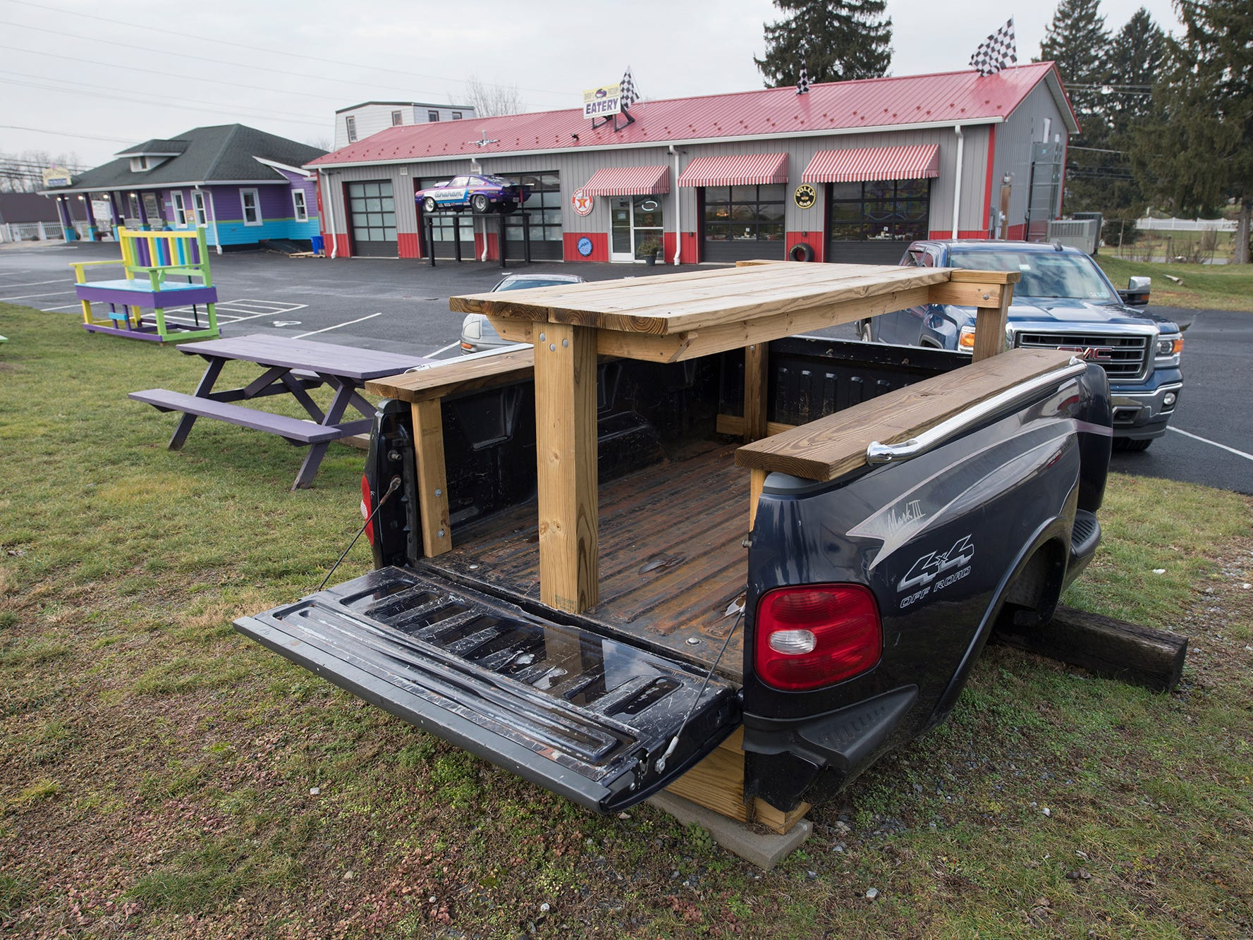 A picnic table made out of a pickup truck bed at Johnny's Raceway Eatery Tuesday January 8, 2019.