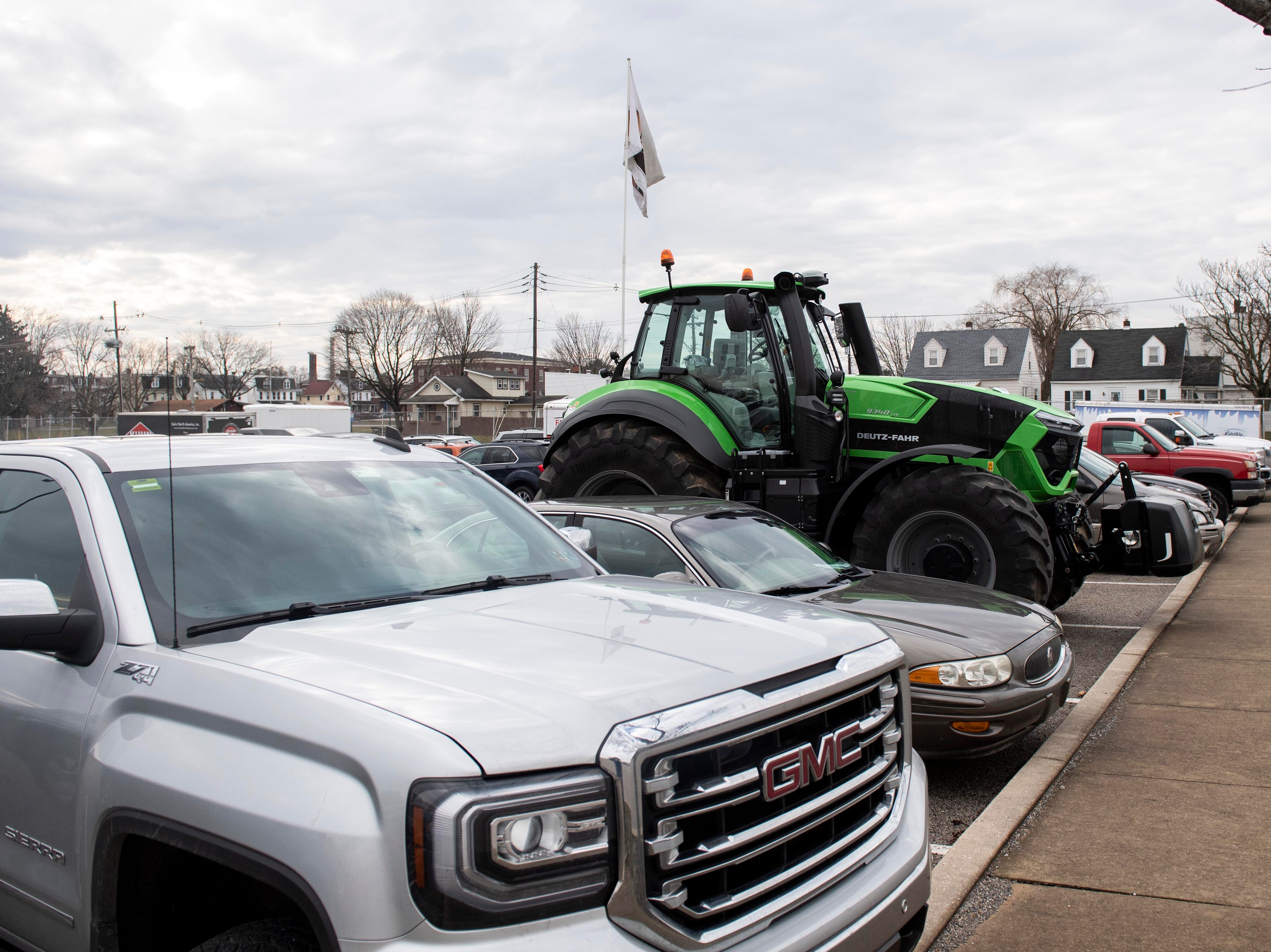 A tractor, seen for advertising, is parked among attendee parking at the Keystone Farm Show, Tuesday, Jan. 8, 2019. The Keystone Farm Show has nearly 420 vendors and is expected to bring up to 15,000 people to the York Expo Center. The show runs through Thursday, Jan. 10.