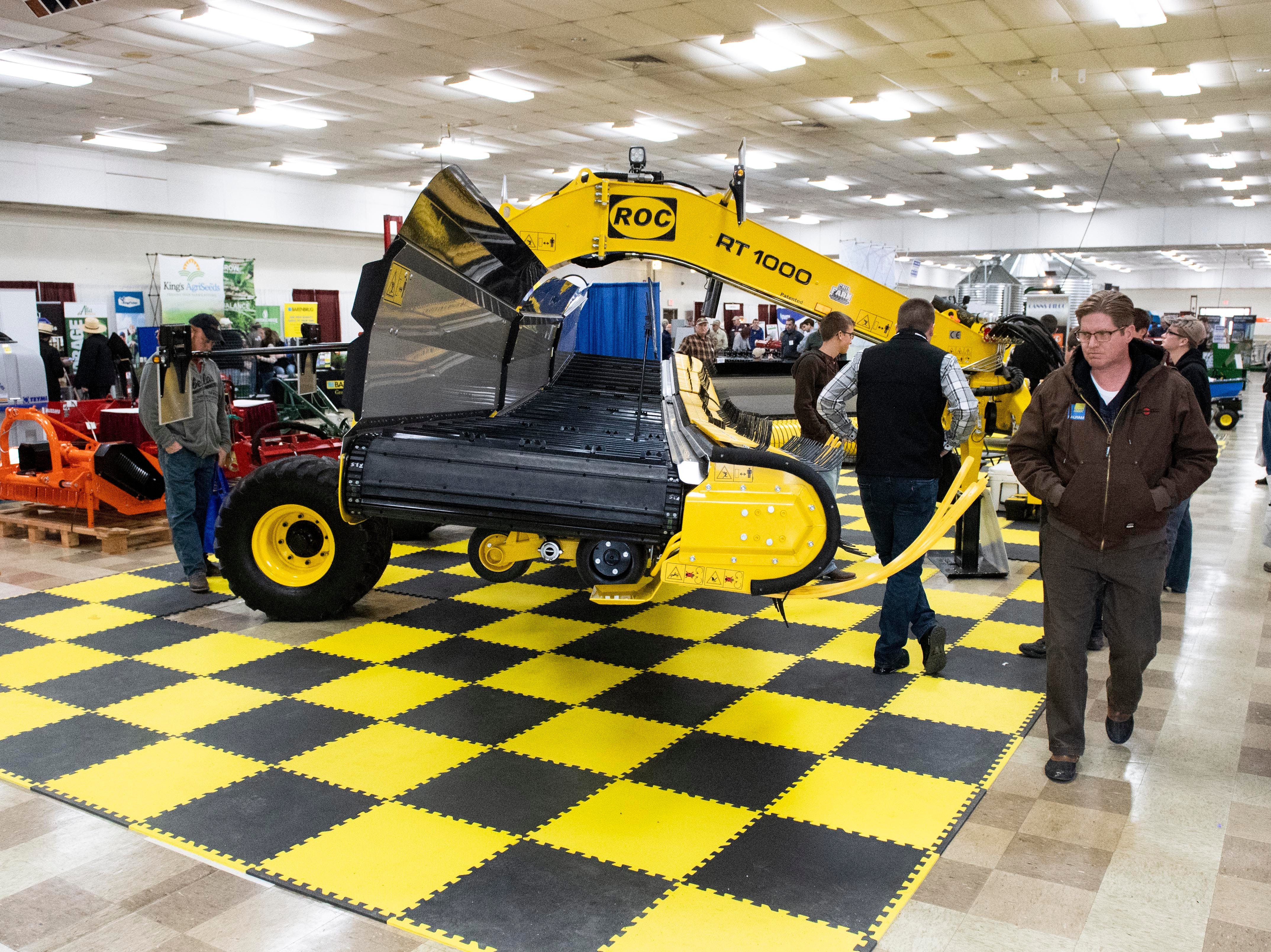 People check out an ROC RT1000 merger during the Keystone Farm Show, Tuesday, Jan. 8, 2019. The Keystone Farm Show has nearly 420 vendors and is expected to bring up to 15,000 people to the York Expo Center. The show runs through Thursday, Jan. 10.
