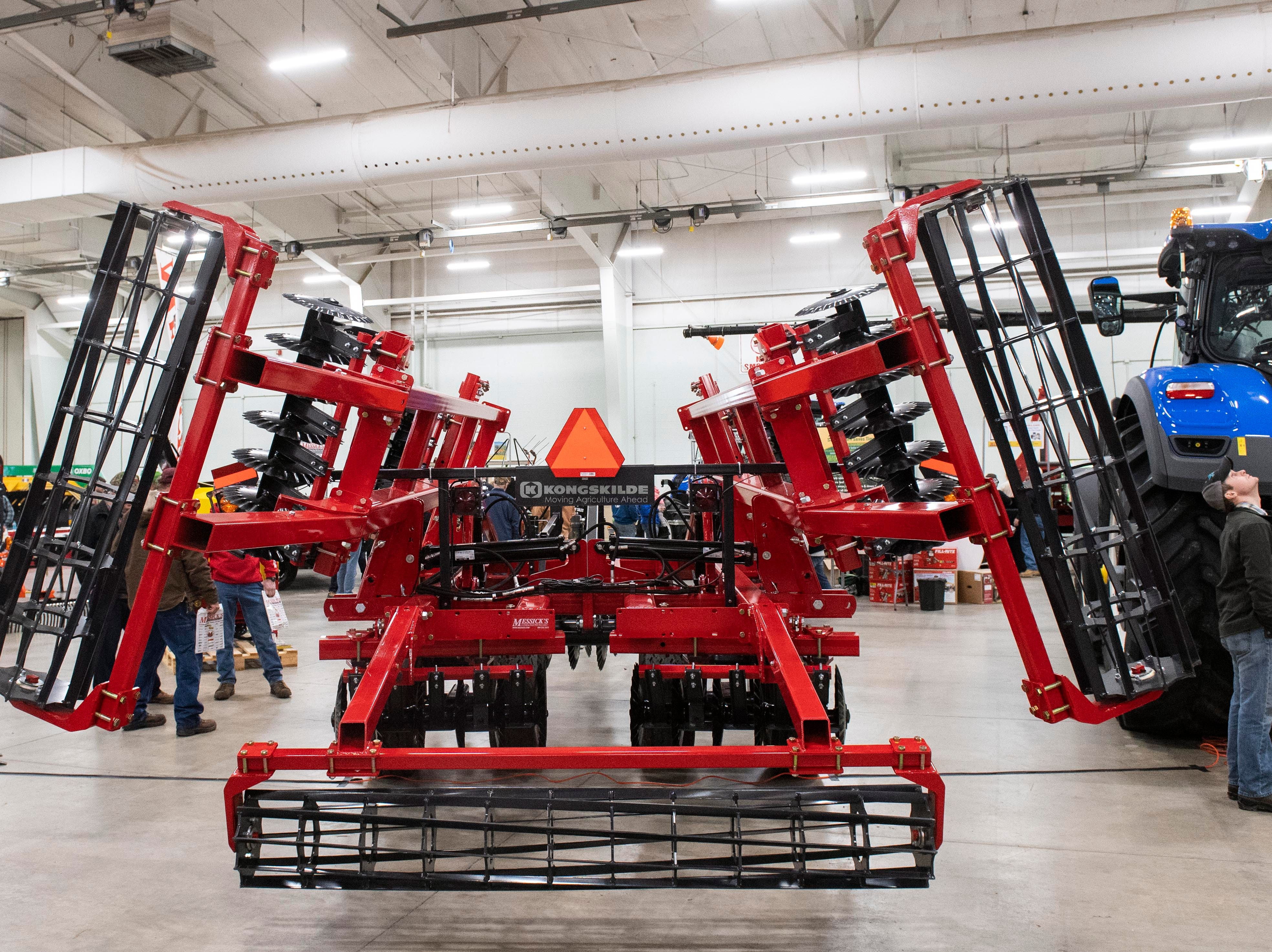 Large farm equipment fills the inside of Utz Arena and other buildings on Tuesday, Jan. 8, 2019. The Keystone Farm Show has nearly 420 vendors and is expected to bring up to 15,000 people to the York Expo Center. The show runs through Thursday, Jan. 10.