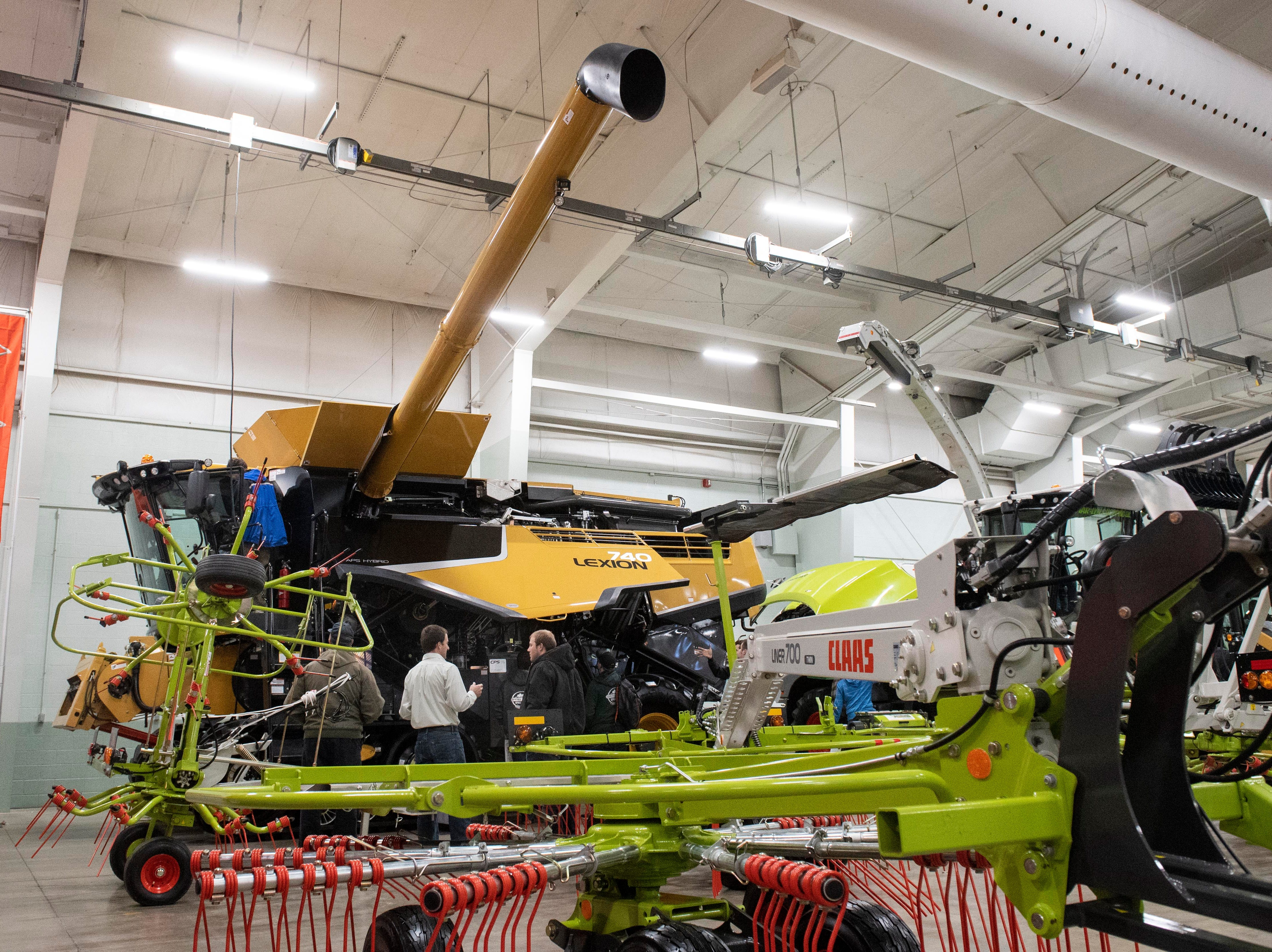 From harvesters to hay bailers, nearly every piece of agricultural equipment sits on display for potential buyers to check out, Tuesday, Jan. 8, 2019. The Keystone Farm Show has nearly 420 vendors and is expected to bring up to 15,000 people to the York Expo Center.