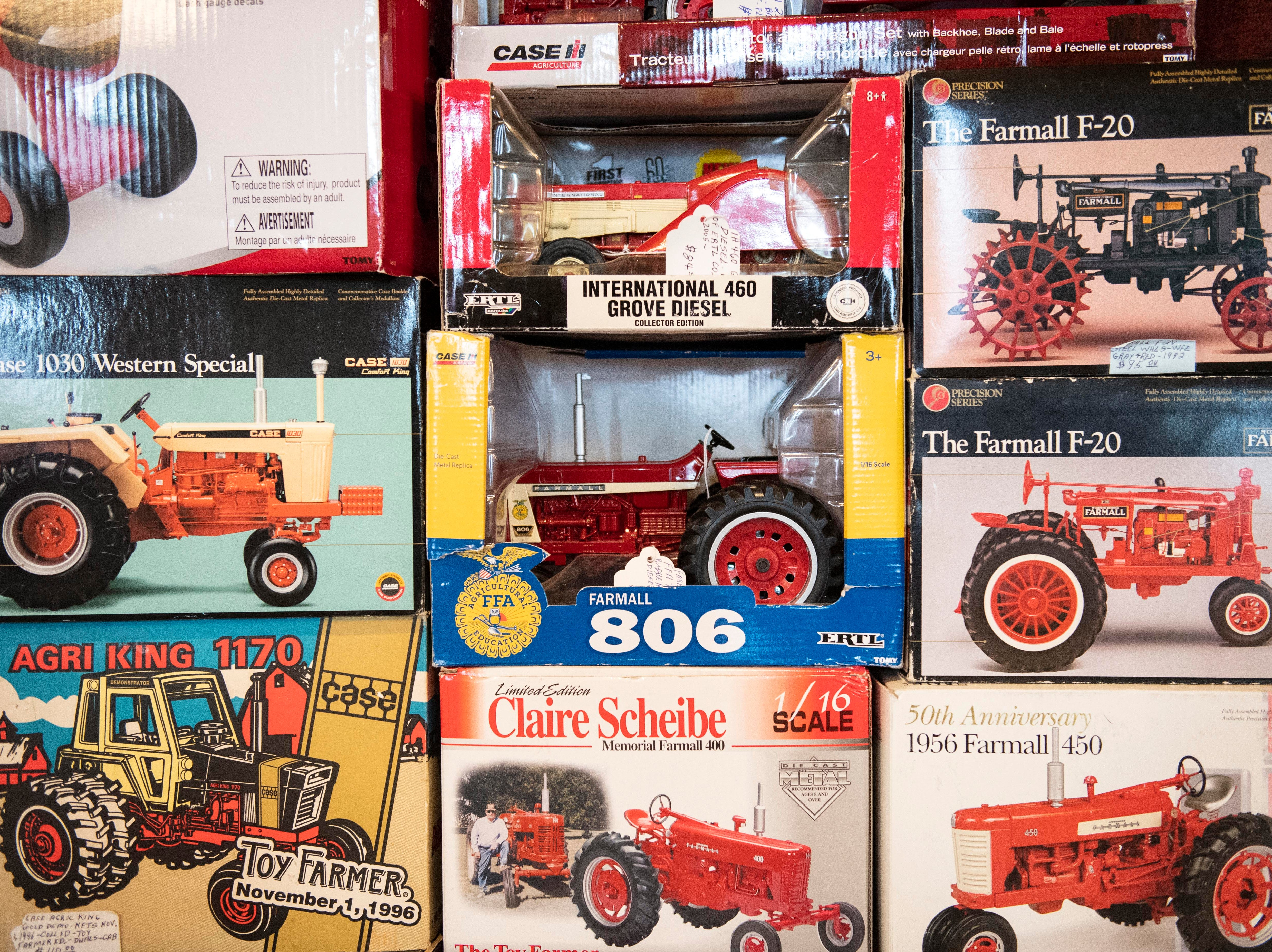 Classic tractor toys are seen stacked up, Tuesday, Jan. 8, 2019. The Keystone Farm Show has nearly 420 vendors and is expected to bring up to 15,000 people to the York Expo Center. The show runs through Thursday, Jan. 10.