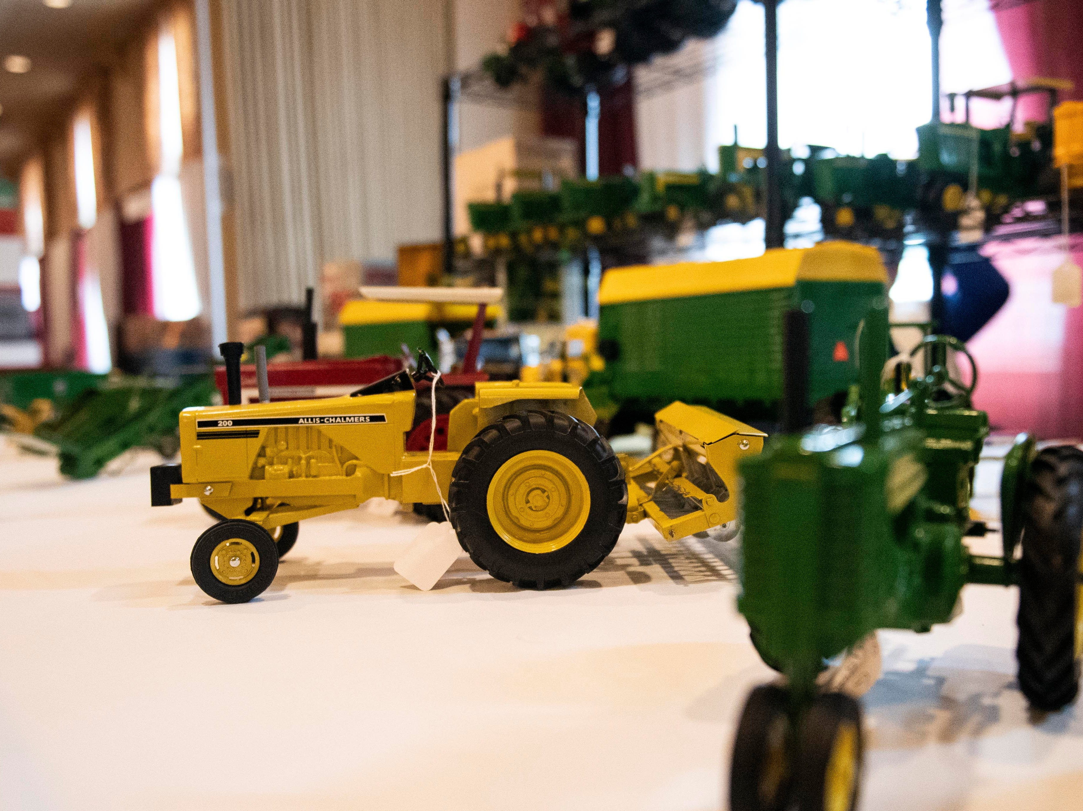 Tractor figurines sit on display in the toy building at the Keystone Farm Show, Tuesday, Jan. 8, 2019. The Keystone Farm Show has nearly 420 vendors and is expected to bring up to 15,000 people to the York Expo Center. The show runs through Thursday, Jan. 10.