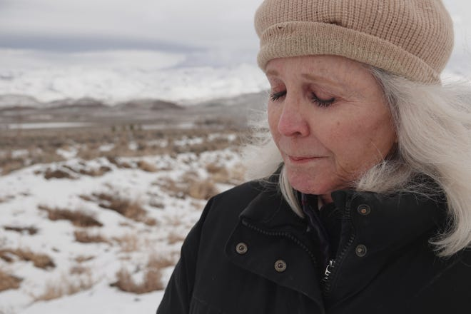 Kate Carlson laments the loss of three horses she cared for on her property in Palomino Valley. The horses were herded away during a Pyramid Lake Paiute Tribe feral horse roundup. Carlson said the roundup workers trespassed on her land and she fears the horses will be sent to slaughter.