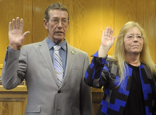 Lyon County Commissioners Greg Hunewill (left) and Vida Keller take the oath.