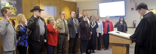 Judge Leon Aberasturi swears in Lyon County's incoming elected officials.