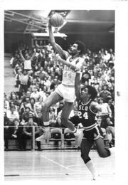 Monroe 'Pops' McTaw, shown playing for the College at Brockport, was a Section V star who added style and flare to the game of basketball.