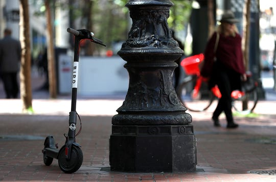 A Bird scooter sits parked on a street corner on April 17, 2018 in San Francisco, California.