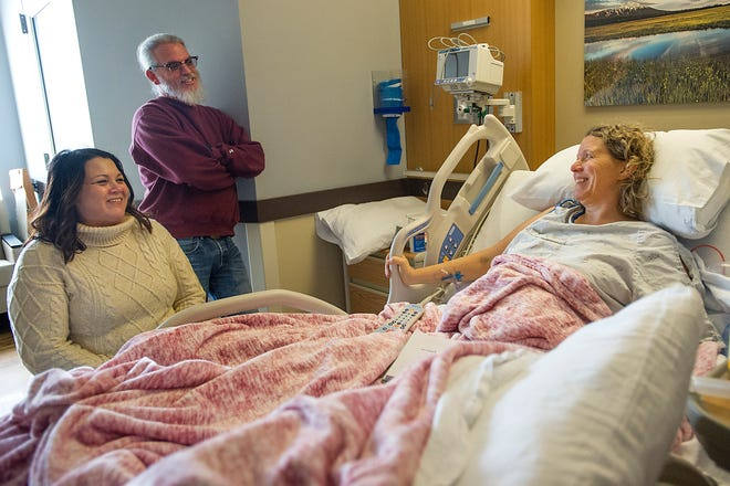 Katie Ciancetta, 48, visits with her brother Tim Gogl and his wife Michele Scalise while recovering Friday Jan. 4, 2019, at St. Charles Medical Center in Bend. Ciancetta was involved in a sledding accident on New Year's Eve at Santiam Sno-Park that has left her paralyzed.