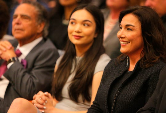 Incoming Monterey County District Attorney listens as speakers describe her at her swearing in ceremony.