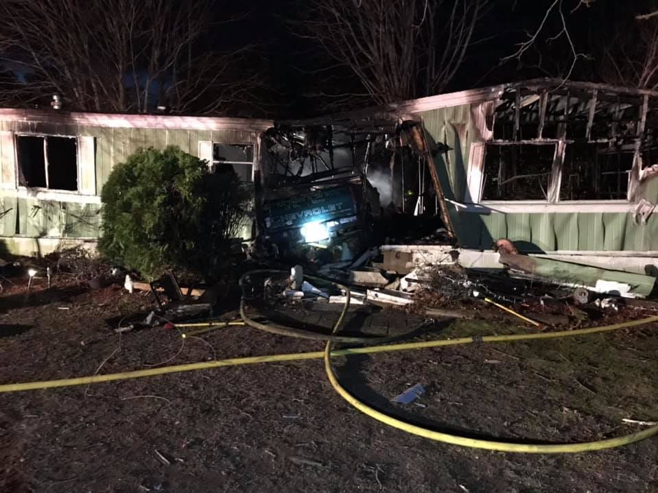 A vehicle crashed into a Wachapreague home igniting a fire and damaging the home Monday.