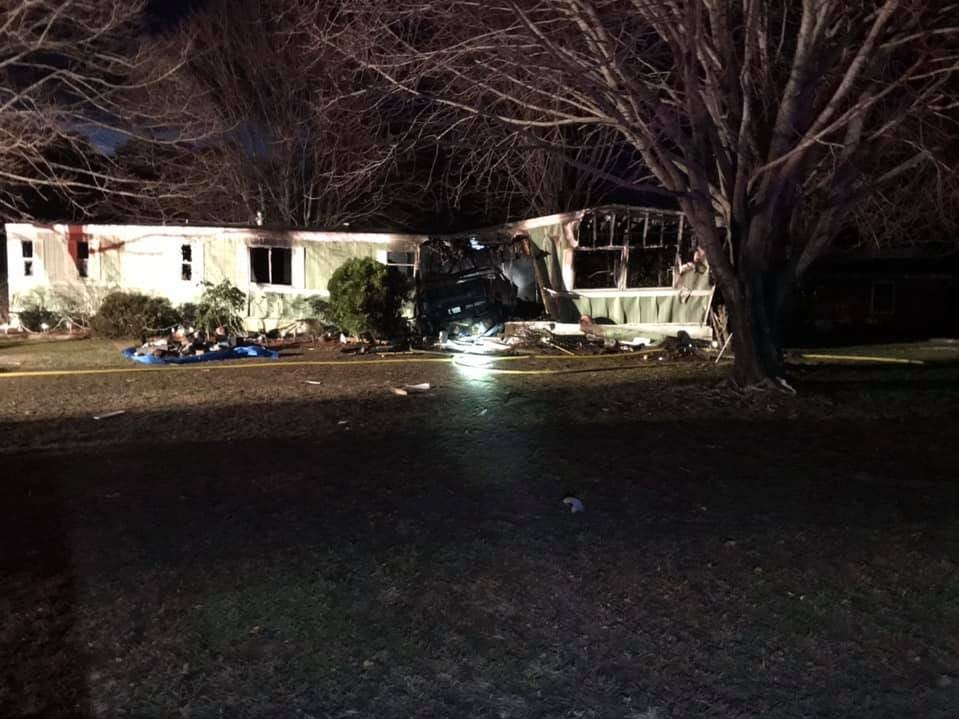A fire ignited after a vehicle crashed into a Wachapreague, Virginia, home on Monday left severe damage.