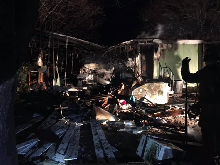 The damage inside a Wachapreague home after a vehicle crash caused a fire.