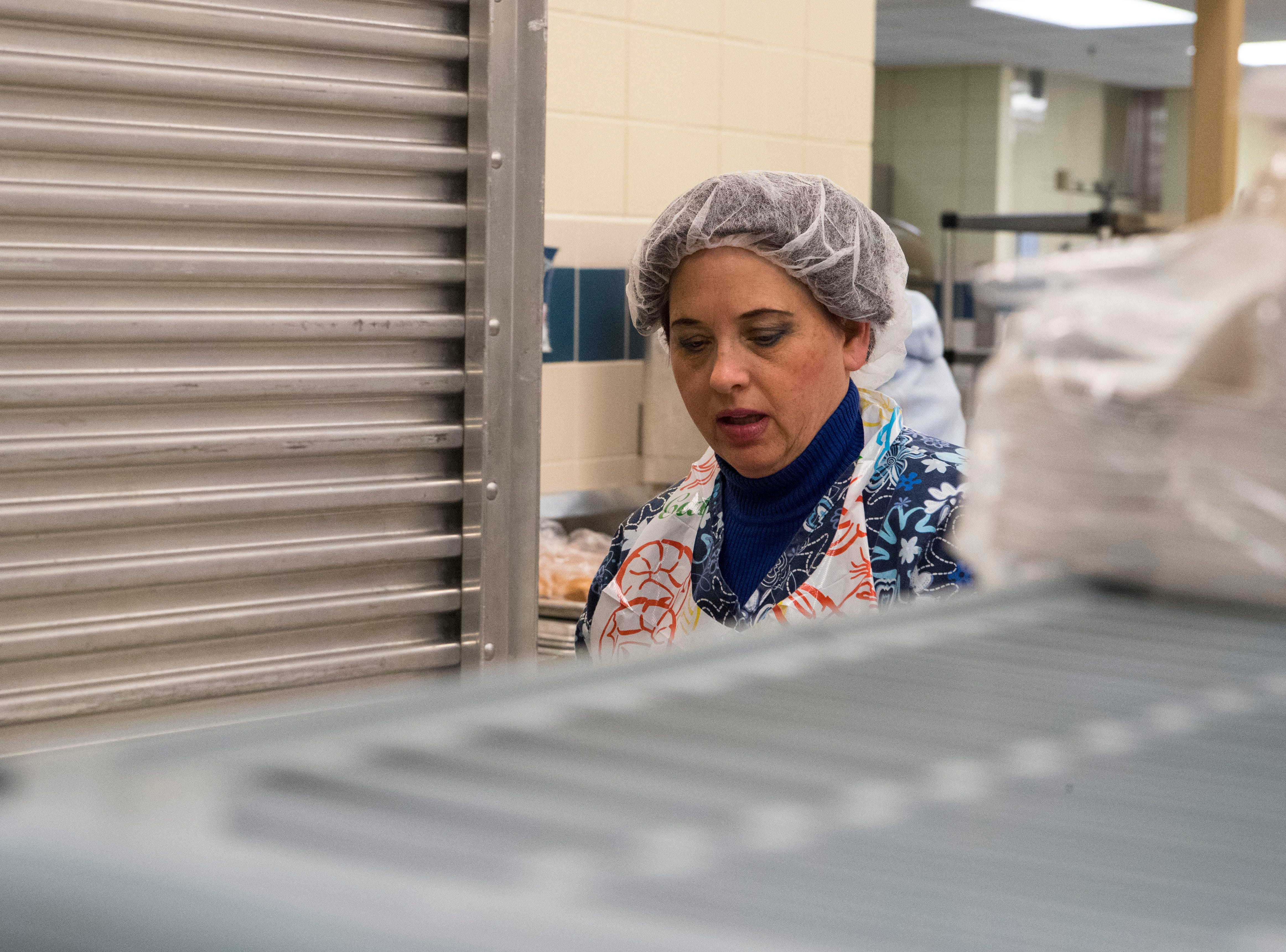 Sonja Rohan prepares meals for the public schools in Sioux Falls, S.D. at Child Nutrition Service, Tuesday, Jan. 8, 2019.