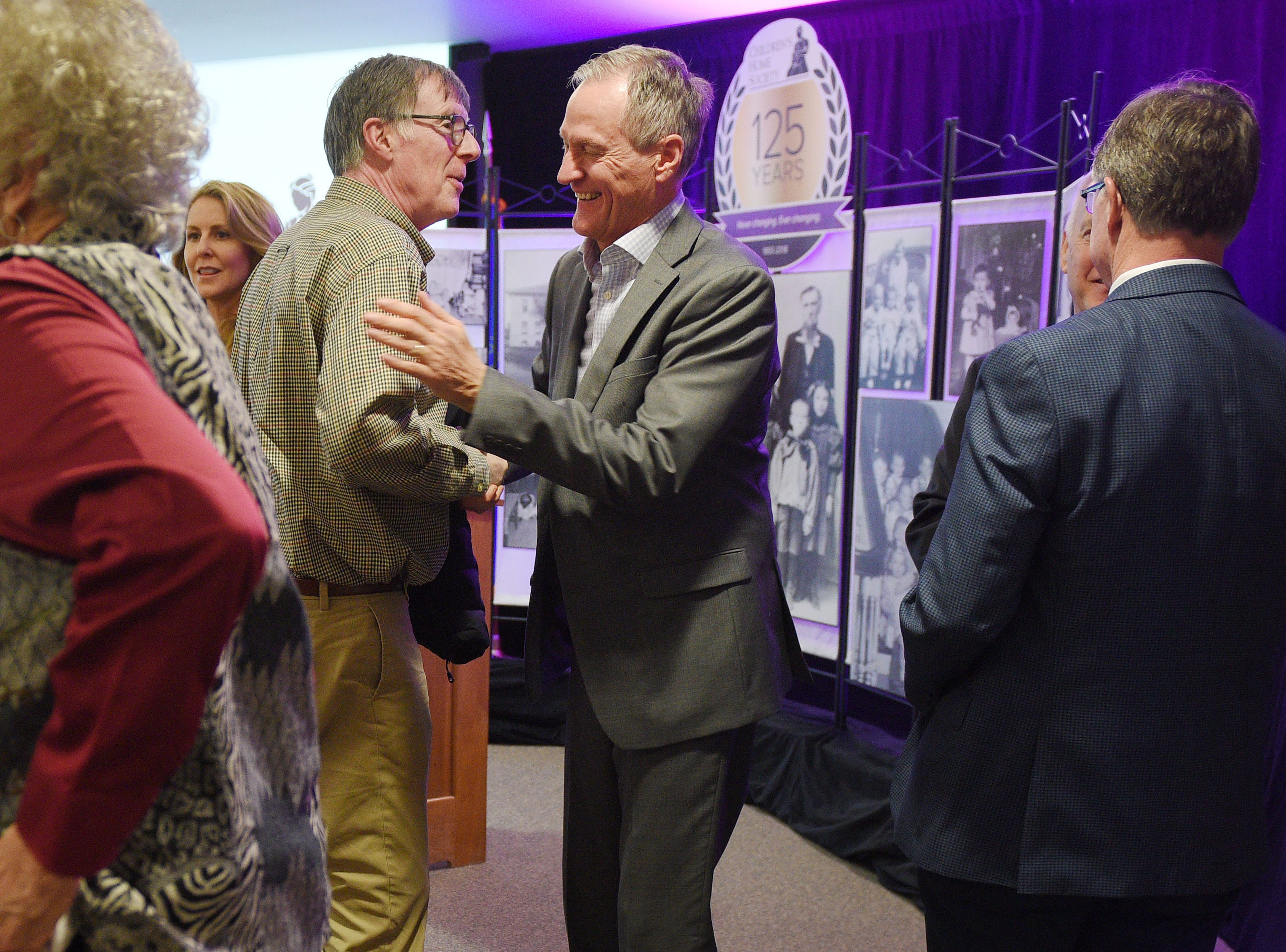 Former governor Dennis Daugaard greets people after a press conference about philanthropist T. Denny Sanford donating  $55 million to Children's Home Society Tuesday, Jan. 8, in Sioux Falls.