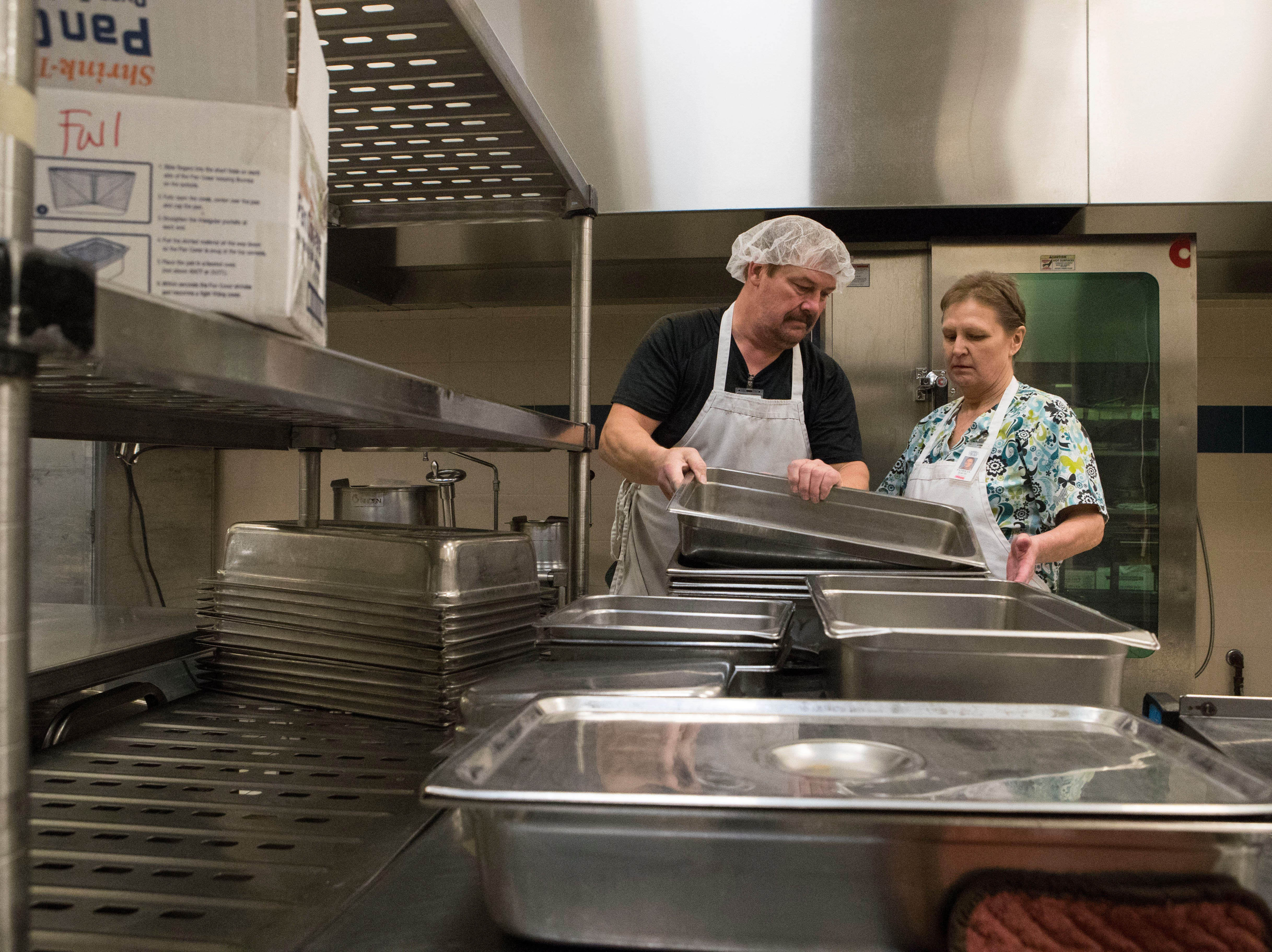 Bob Baade and Patty Davis prepare meals for the public schools in Sioux Falls, S.D. at Child Nutrition Service, Tuesday, Jan. 8, 2019.