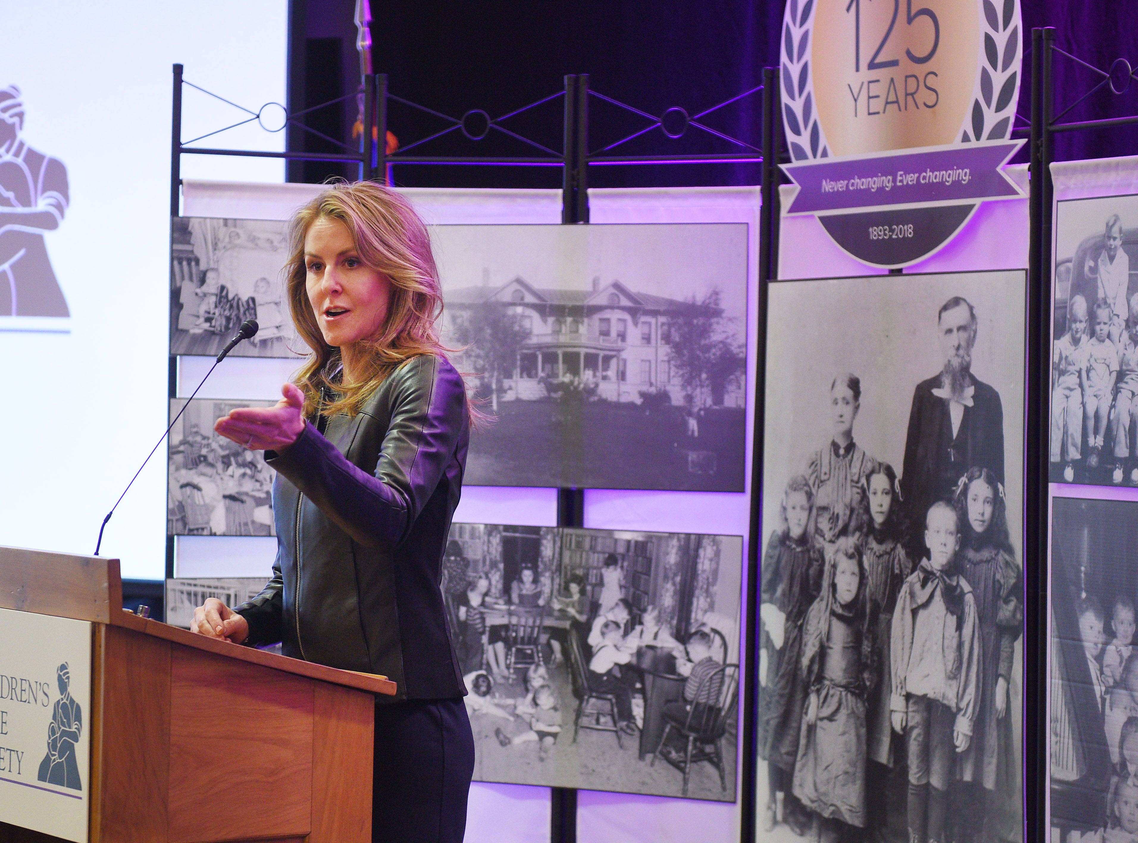 Children's Home Society board president Meg Warder announces Tuesday, Jan. 8, philanthropist T. Denny Sanford donated $55 million to the shelter in Sioux Falls.