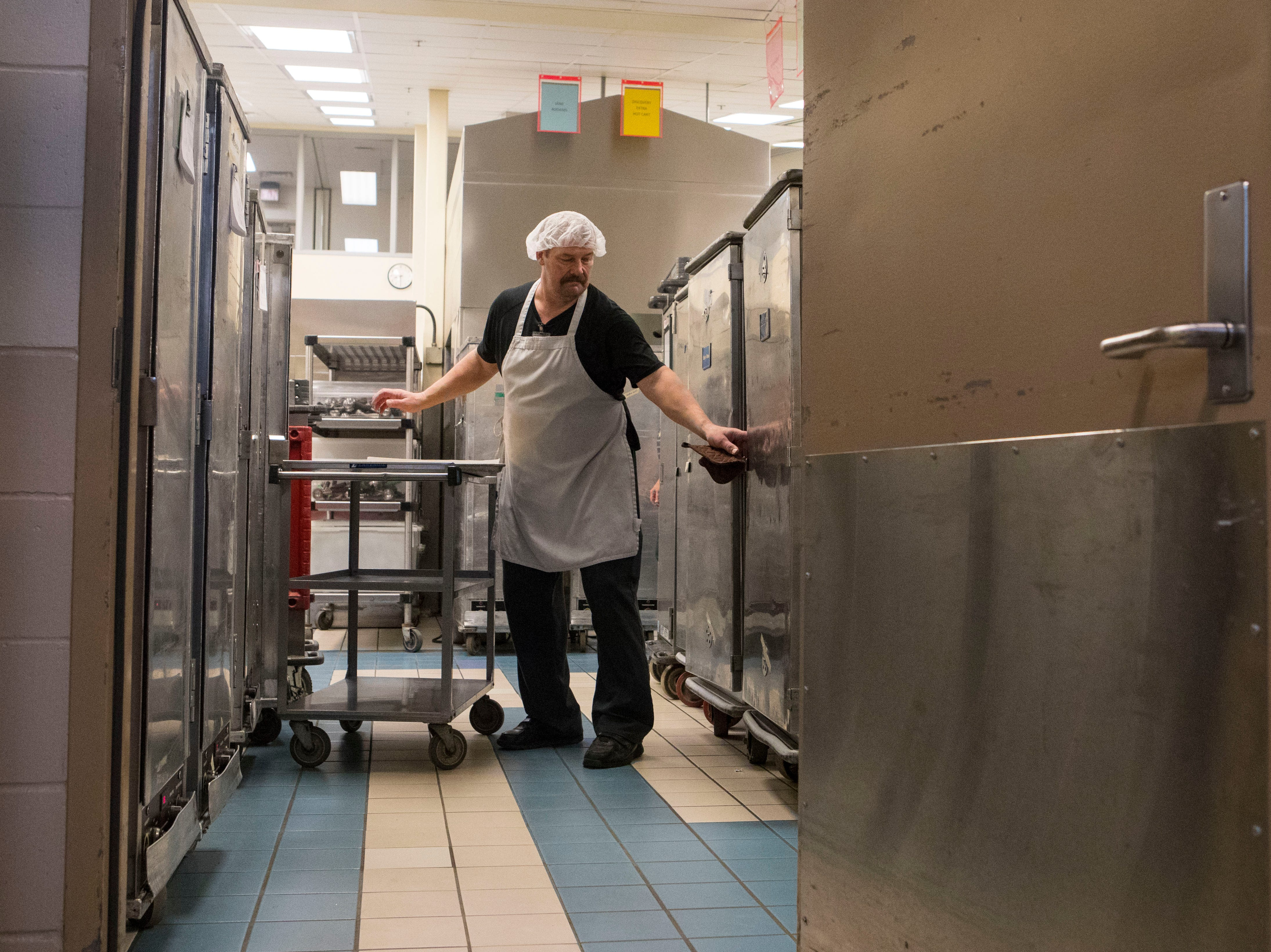 Bob Baade finishes last minute food preparations before the meals are transfer to the schools in Sioux Falls, S.D. at Child Nutrition Service, Tuesday, Jan. 8, 2019.