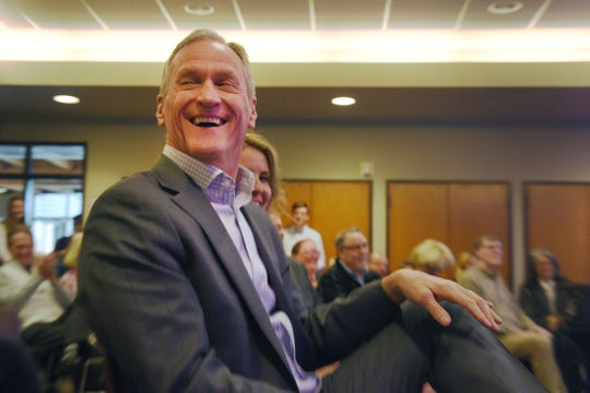 Former governor Dennis Daugaard laughs at a joke T. Denny Sanford made about Sanford's $55 million donation to Children's Home Society Tuesday, Jan. 8, in Sioux Falls. Sanford said Daugaard picked his pocket.