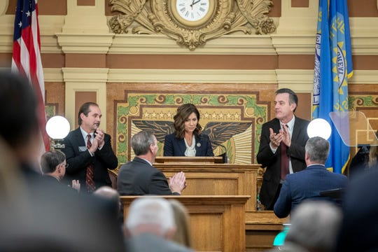 South Dakota Gov. Kristi Noem receives a standing ovation after delivering her first State of the State address at the state Capitol in Pierre, S.D., Tuesday, Jan. 8, 2019. (Ryan Hermens/Rapid City Journal via AP)