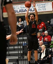 St. Cloud State's Gage Davis is about to break the school record for points set by Dan Hagen, who played from 1977-81. Here he takes a shot at a recent game at Halenbeck Hall.