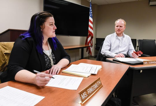 New St. Cloud school board members Natalie Ringsmuth and Zachary Dorholt talk about their first meeting as they fill out paperwork Monday, Jan. 7, at the district offices in Waite Park.