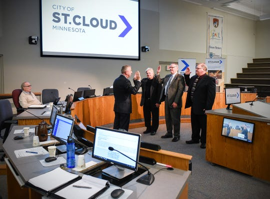 St. Cloud Mayor Dave Kleis swears in council members Dave Masters, Steve Laraway and Mike Conway on Monday, Jan. 7, at St. Cloud City Hall.