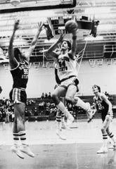 Dan Hagen drives for the basket, St. Cloud State University, 1979