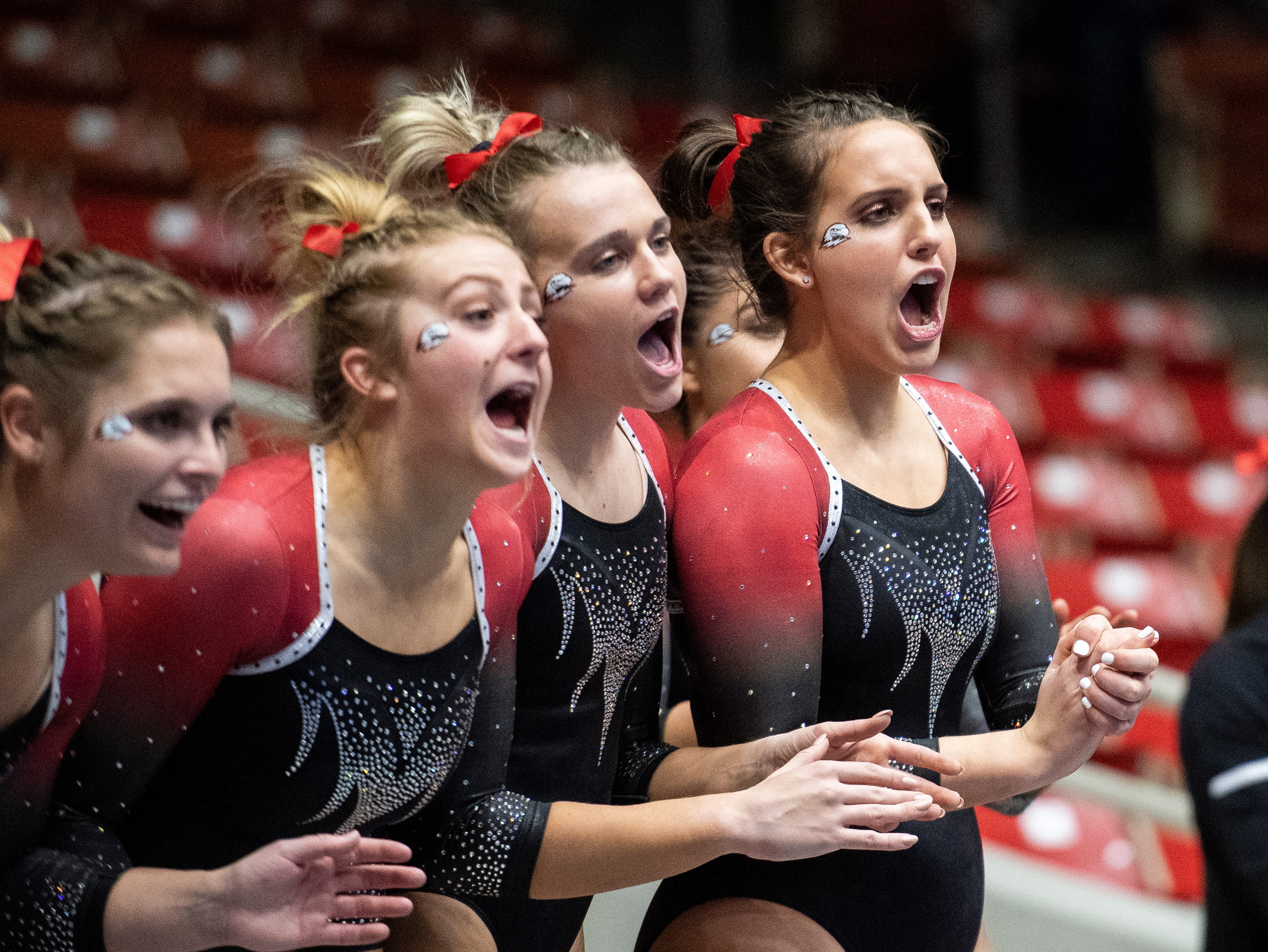The Southern Utah Flippin' T-Birds cheer on a teammate during their floor routine against New Hampshire in the America First Event Center Monday, January 7, 2019.