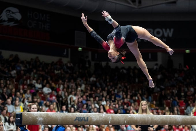 Southern Utah University senior Karen Gonzalez flips on the beam against New Hampshire in the America First Event Center Monday, January 7, 2019.