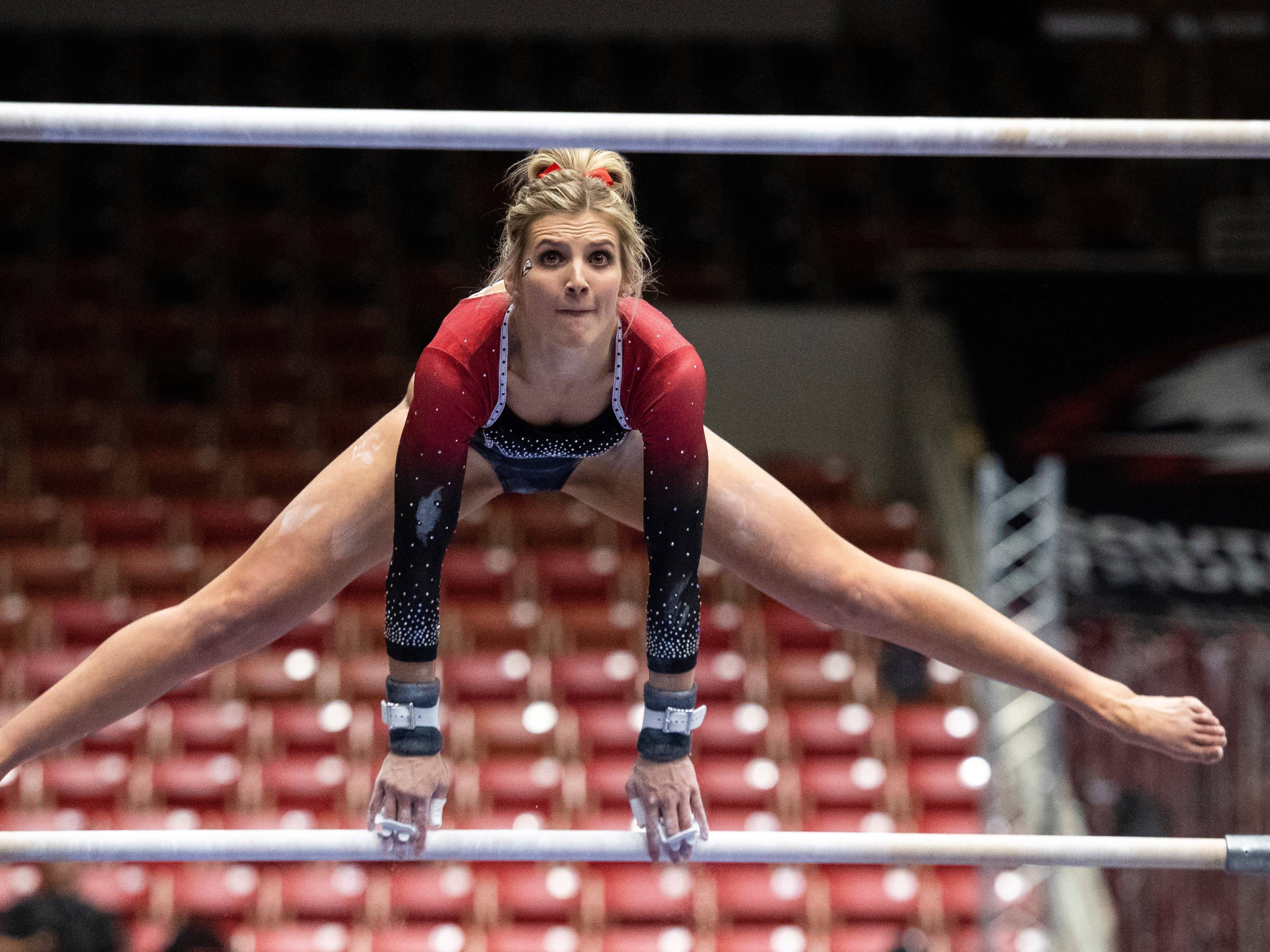 Southern Utah University junior Becky Rozsa-Thompson competes on the uneven bars against New Hampshire in the America First Event Center Monday, January 7, 2019.