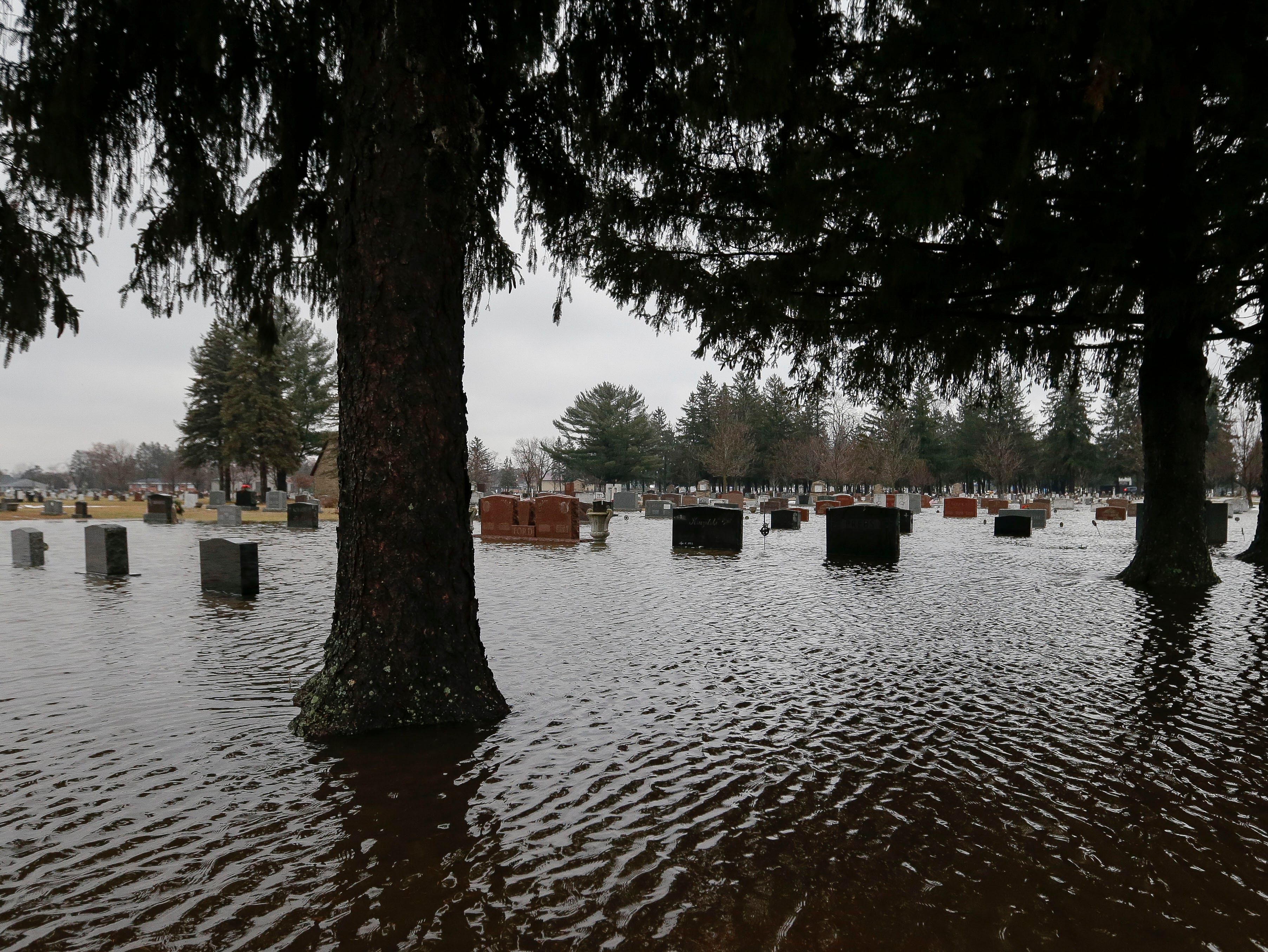 Flood waters overtake part of Guarian Angel Cemetery on Monday, January 7, 2019, in Stevens Point, Wis. Tork Mason/USA TODAY NETWORK-Wisconsin